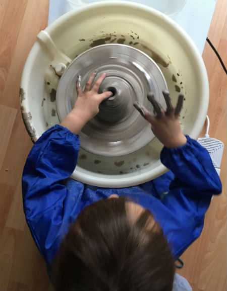 Child at Potters Wheel
