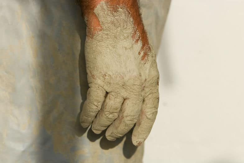dry hands from pottery clay