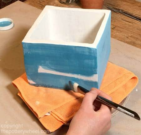 applying underglaze to sgraffito pottery