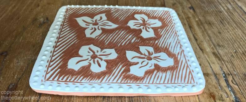 how do you make sgraffito pottery with slip