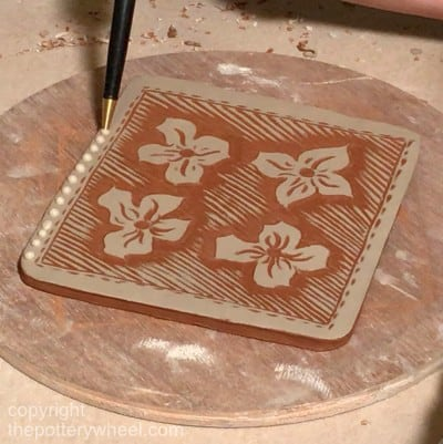 slip trailing with sgraffito slip pottery