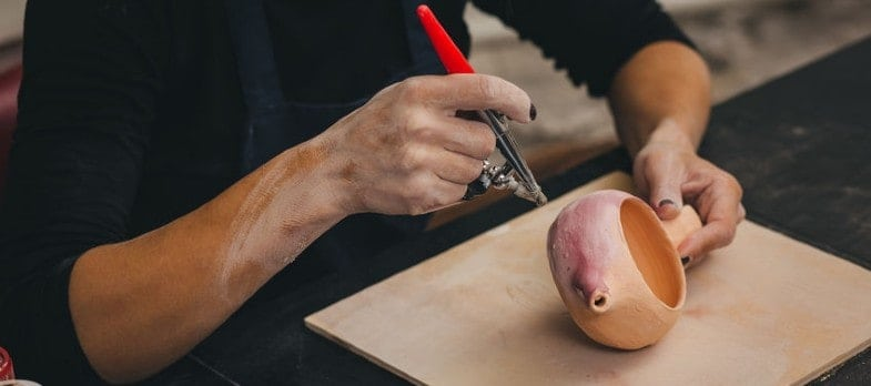 thinners can enable glaze to be sprayed onto pottery