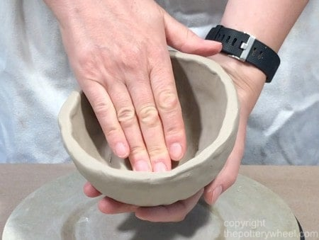smoothing out the clay
